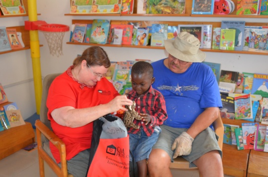 Becki and Bruce with John, the child they sponsor